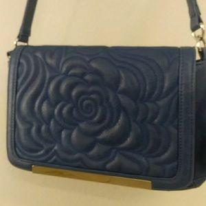 Carlos Santana blue purse